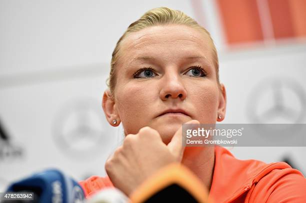 Alexandra Popp of Germany reacts during a press conference at Montreal Convention Centre on June 24 2015 in Montreal Canada