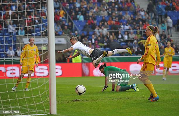 Alexandra Popp of Germany scores fourth goal during the UEFA Womens Euro 2013 qualification match between Germany and Romania at the Schueco Arena on...