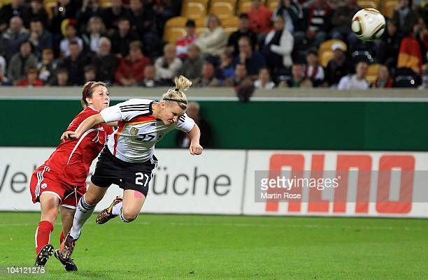 Alexandra Popp of Germany scores her team's 3rd goal during the Women's International Friendly match between Germnay and Canada at Rudolf Harbig...
