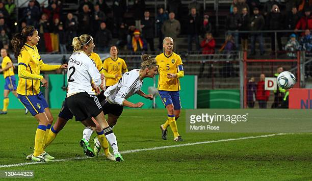 Alexandra Popp of Germany scores her team's opening goal during the Women's International friendly match between Germany and Sweden on October 26,...