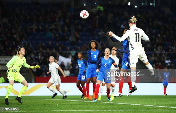 Alexandra Popp of Germany scores the first goal during the Germany v France Women's International Friendly match at Schueco Arena on November 24 2017...