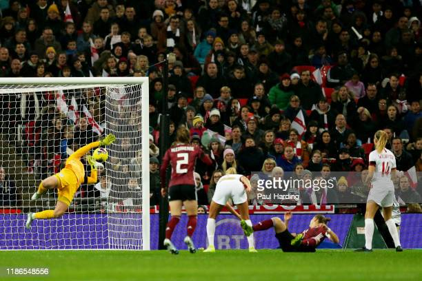 Alexandra Popp of Germany scores the opening goal during the International Friendly between England Women and Germany Women at Wembley Stadium on...