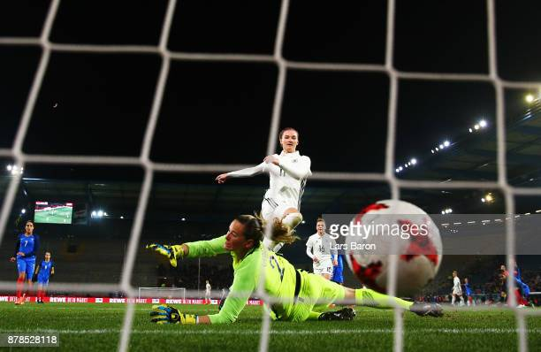 Alexandra Popp of Germany scores the third goal past Meline Gerard of France during the Germany v France Women's International Friendly match at...