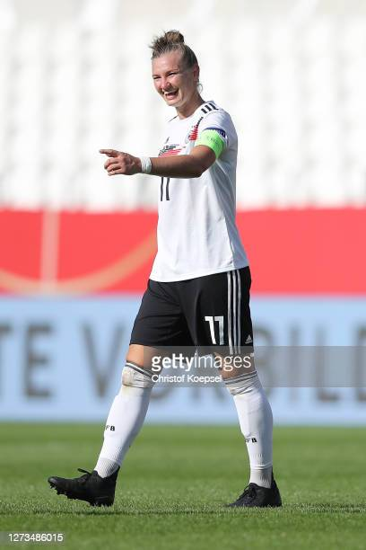 Alexandra Popp of Germany smiles after winning 30 the UEFA Women's EURO 2022 Qualifier match between Germany and Ireland at Stadion Essen on...