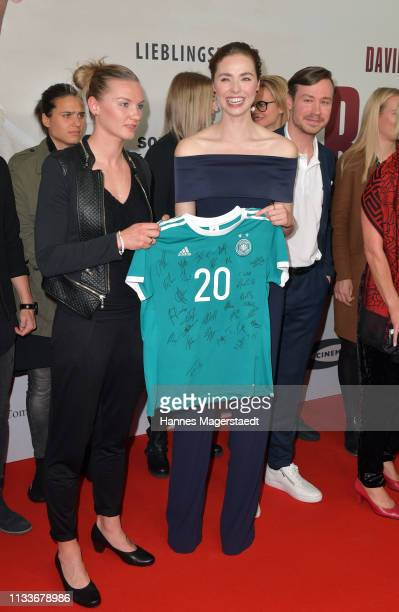 Alexandra Popp of Germany women's soccer team actress Freya Mavor and David Kross attend the premiere of the film Trautmann at Mathaeser Filmpalast...