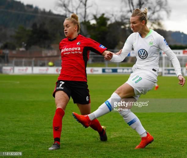 Alexandra Popp of Vfl Wolfsburg against Giulia Gwinn of Freiburg during the Allianz Frauen Bundesliga football match between SC Freiburg and Vfl...