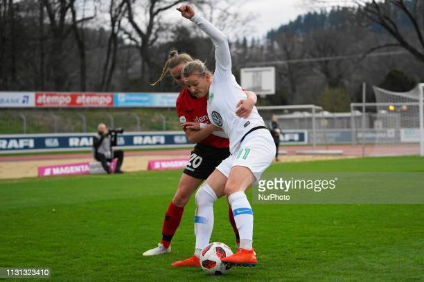 Alexandra Popp of Vfl Wolfsburg against the Freiburg defense during the Allianz Frauen Bundesliga football match between SC Freiburg and Vfl...