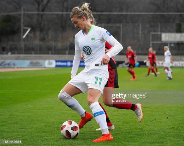 Alexandra Popp of Vfl Wolfsburg against the SC Freiburg defense during the Allianz Frauen Bundesliga football match between SC Freiburg and Vfl...
