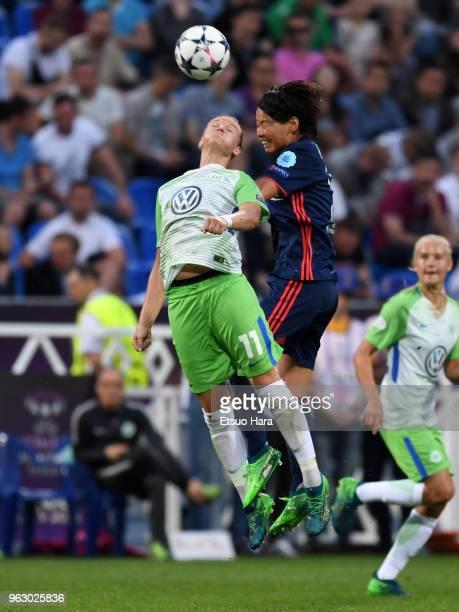 Alexandra Popp of Wolfsburg and Saki Kumagai of Olympique Lyonnais compete for the ball during the UEFA Womens Champions League Final between VfL...