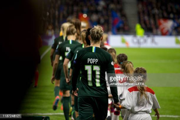 Alexandra Popp of Wolfsburg arrives with team mates for the line up ceremony ahead of the UEFA Women's Champions League Quarter Final First Leg match...