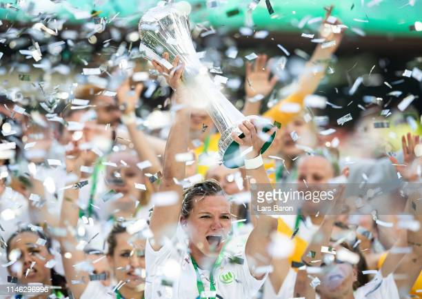 Alexandra Popp of Wolfsburg celebrates with the trophy after winning the Women's DFB Cup final match between VfL Wolfsburg and SC Freiburg at...