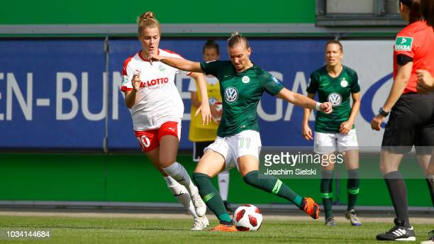 Alexandra Popp of Wolfsburg challenges Laura Freigang of Frankfurt during the Allianz Frauen Bundesliga match between VfL Wolfsburg and 1 FFC...