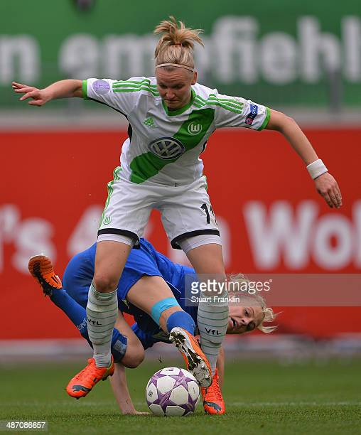 Alexandra Popp of Wolfsburg in action against Johanna Elsig of Postdam during the UEFA Women's Champions League semi final second leg match between...