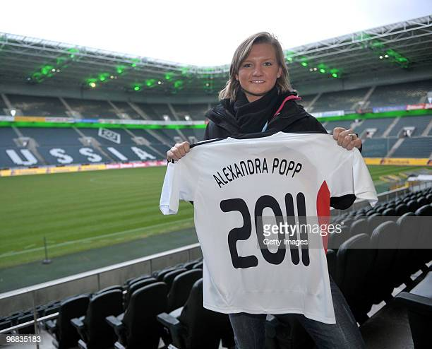 Alexandra Popp presents a jersey prior the FIFA Women's World Cup 2011 Countdown event at the Borussia Park Arena on February 18 2010 in...