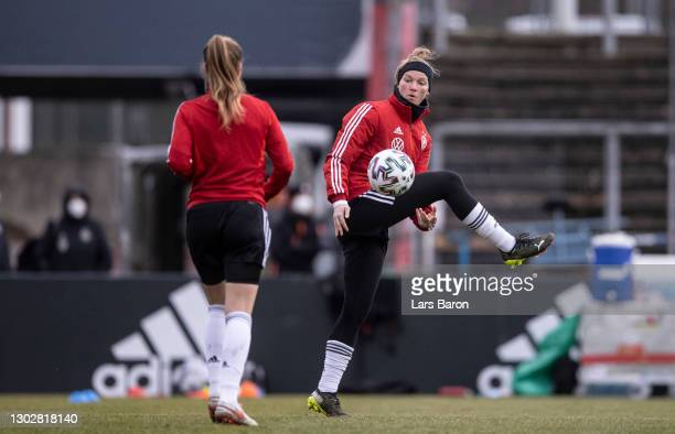 Alexandra Popp warms up with team mates during a training session at Suedstadion on February 18, 2021 in Cologne, Germany.Germany plays the 'Three...