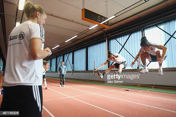 Alexandra Popp watches Verena Faisst and Celia Sasic exercise during a performance test of the German women's national team at Sporthochschule on...