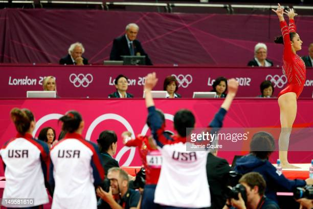 Alexandra Raisman of the United States reacts after her floor exercise as her teammates cheer her on in the Artistic Gymnastics Women's Team final on...