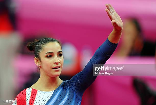 Alexandra Raisman of the United States waves to the crowd after winning the gold medal for the Artistic Gymnastics Women's Beam final on Day 11 of...