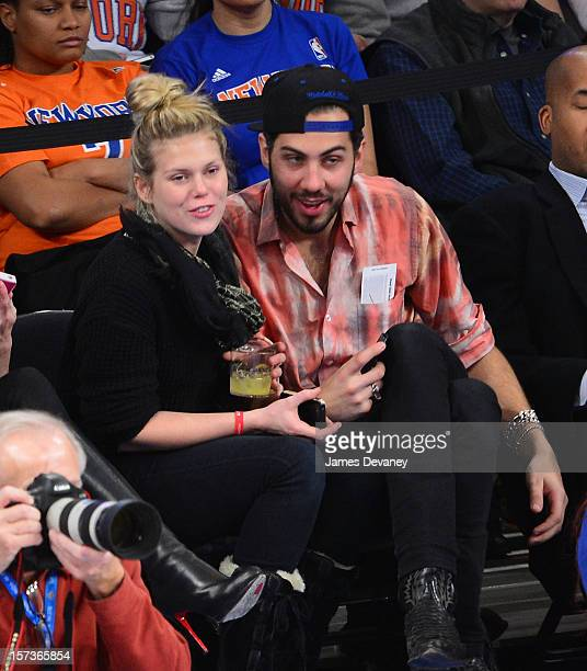 Alexandra Richards and guest attend the Phoenix Suns vs New York Knicks game at Madison Square Garden on December 2 2012 in New York City