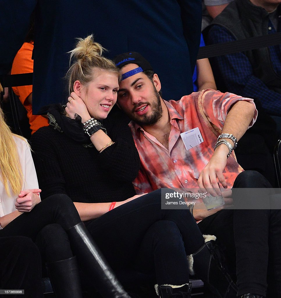 Alexandra Richards and guest attend the Phoenix Suns vs New York Knicks game at Madison Square Garden on December 2, 2012 in New York City.