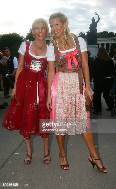 Alexandra Rietz and TV presenter Tina Kaiser arrive for the 'Kaefer's Almauftrieb' party at Kaefer beer tent during day 2 of Oktoberfest beer...
