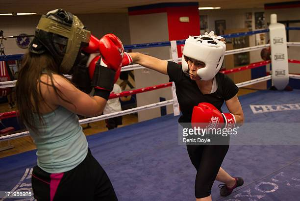 Alexandra Rodriguez throws a punch during a practice sparring session with Joana Pastrana at the Rayo Vallecano boxing club on June 27 2013 in Madrid...