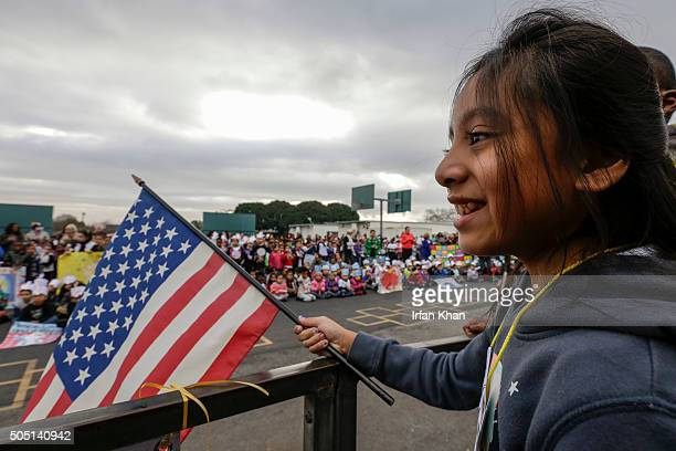 JANUARY 15 2016 Alexandra Rojas a 5th grader holds a flag at a rally and 11th annual Stepping Out for Peace March held by students at 186th Street...