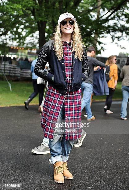 Alexandra Rosano is seen wearing an Urban Outfitters jacket Brooklyn baseball cap and Timberland boots during the 2015 Governors Ball Music Festival...