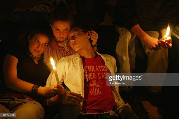 Alexandra Rosenberg Mimi Lester and Misko Lencek Inagaki participate in a candle light vigil for victims of the World Trade Center attack September...