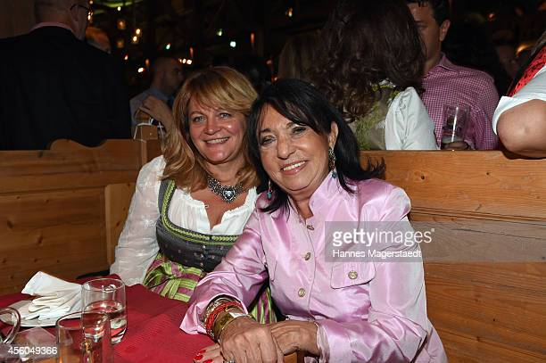 Alexandra Schoerghuber and Regine Sixt attend the Radio Gong 963 Wiesn at Weinzelt during Oktoberfest at Theresienwiese on September 24 2014 in...