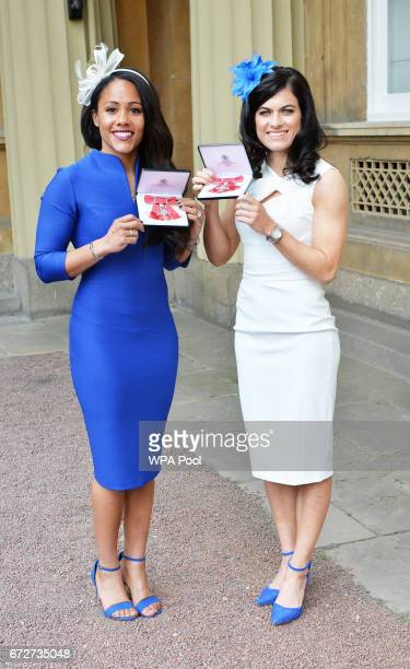 Alexandra Scott and Karen Carney after they were awarded MBEs for services to football by the Princess Royal during an Investiture ceremony at...