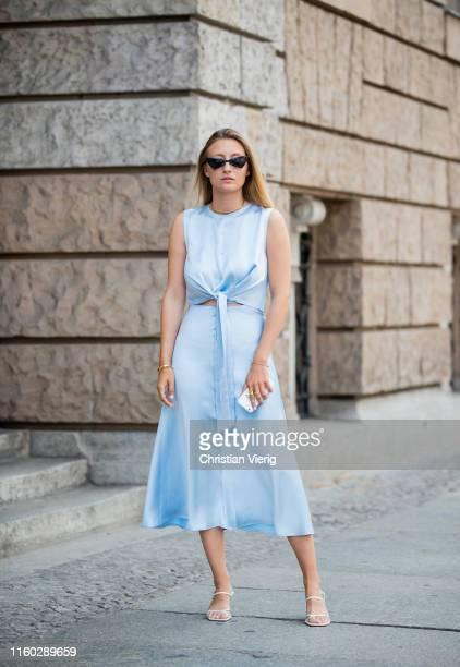 Alexandra Seifert is seen wearing blue Milk White Dress during Berlin Fashion Week on July 04 2019 in Berlin Germany