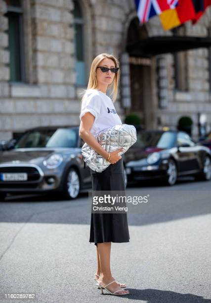 Alexandra Seifert is seen wearing tshirt Jil Sander leather skirt Sportmax Zara sanalds Ralüh Lauren bag is seen during Berlin Fashion Week on July...