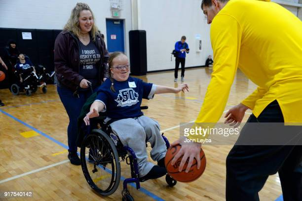 Alexandra Shankle plays defense on Denver Nuggets center Nikola Jokic during the annual Basketball Skills Clinic sponsored by Comfort Dental The...