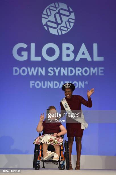 Alexandra Shankle with Miss Colorado Ellery Jones on the runway at the Global Down Syndrome 10th anniversary BBBY fashion show at Sheraton Denver...