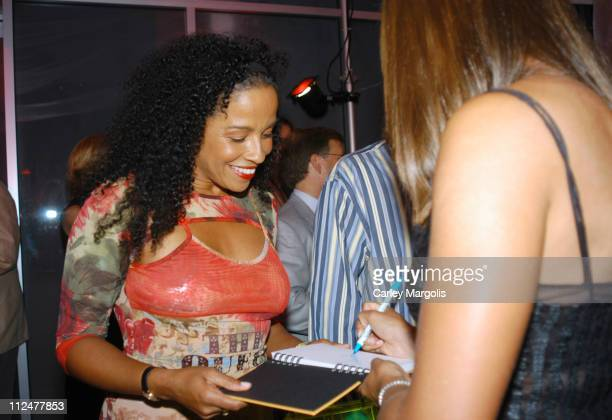 Alexandra Stevenson autographs a book that Rae Dawn Chong will be auctioning for charity