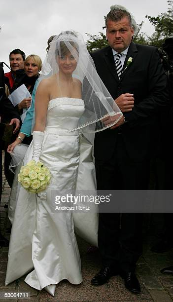Alexandra Stich maiden name Rikowski and her witness to a marriage Thomas Wittlage pose for a photograph at the Sankt Severin church on June 11 2005...