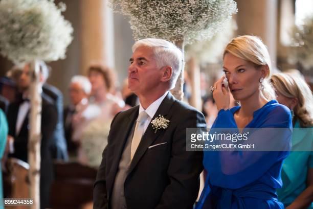 Alexandra Swarovski and her partner Michael Heinritzi attend the wedding of Victoria Swarovski and Werner Muerz on June 16 2017 in Trieste Italy