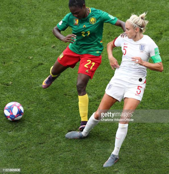 Alexandra Takounda of Cameroon fouls Steph Houghton of England by stamping on her ankle during the 2019 FIFA Women's World Cup France Round Of 16...