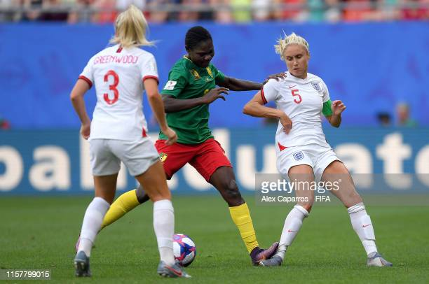 Alexandra Takounda of Cameroon fouls Steph Houghton of England during the 2019 FIFA Women's World Cup France Round Of 16 match between England and...