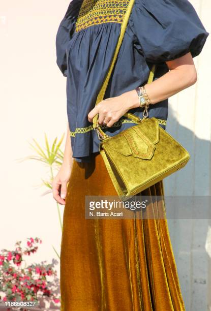 Alexandra Tolstoy poses with Mehry Mu bag during in Balat tour on November 02 2019 in Istanbul Turkey