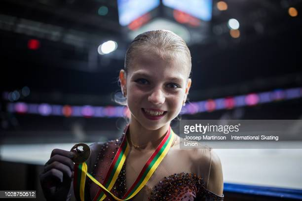 Alexandra Trusova of Russia poses in the Junior Ladies medal ceremony during day two of the ISU Junior Grand Prix of Figure Skating Amber Cup 2018 at...