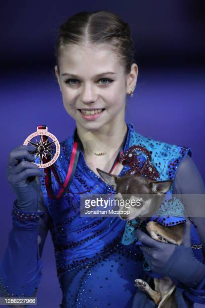 Alexandra Trusova of Russia poses with her Bronze medal and chihuahua during the ISU Grand Prix of Figure Skating Final at Palavela on December 07,...