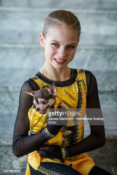Alexandra Trusova of Russia poses with her dog Tina during the ISU Junior Grand Prix of Figure Skating at Irina Rodnina Ice Rink on October 11 2018...