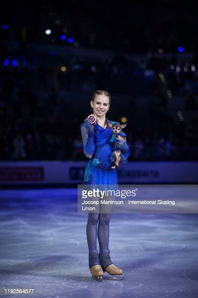 Alexandra Trusova of Russia poses with her dog Tina in the Ladies medal ceremony during the ISU Grand Prix of Figure Skating Final at Palavela Arena...