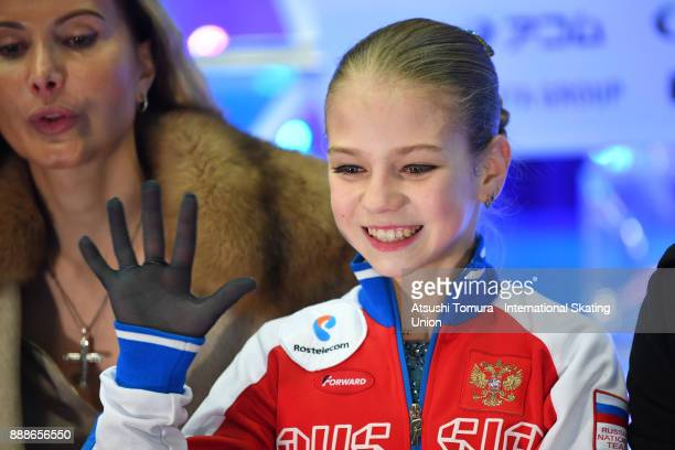 Alexandra Trusova of Russia smiles at the kiss and cry afte the Junior ladies free skating dance during the ISU Junior Senior Grand Prix of Figure...
