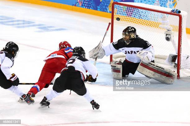 Alexandra Vafina of Russia celebrates scores a goal in the third period against Nana Fujimoto of Japan during the Women's Ice Hockey Preliminary...