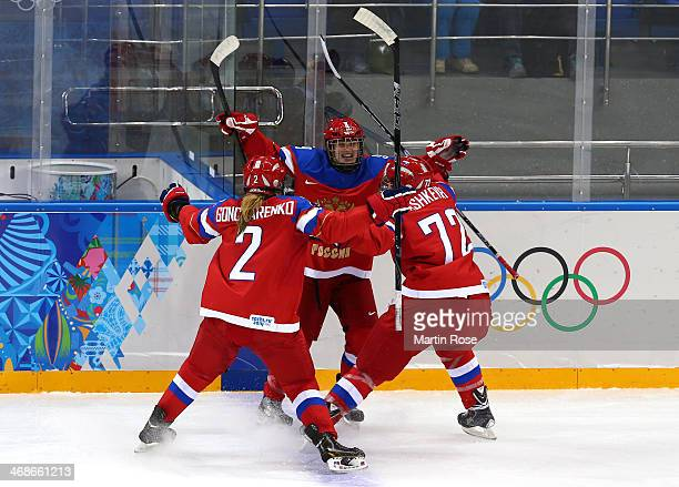 Alexandra Vafina of Russia celebrates with her teammates Angelina Goncharenko and Yekaterina Pashkevich after scoring a goal in the third period...