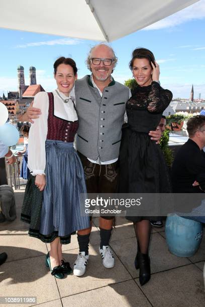 Alexandra von Frankenberg dirndl fashion designer of Amsel Fashion and Peter Olsson and his girlfriend Diana Buergin during the 'Amsel Fashion Wiesn...