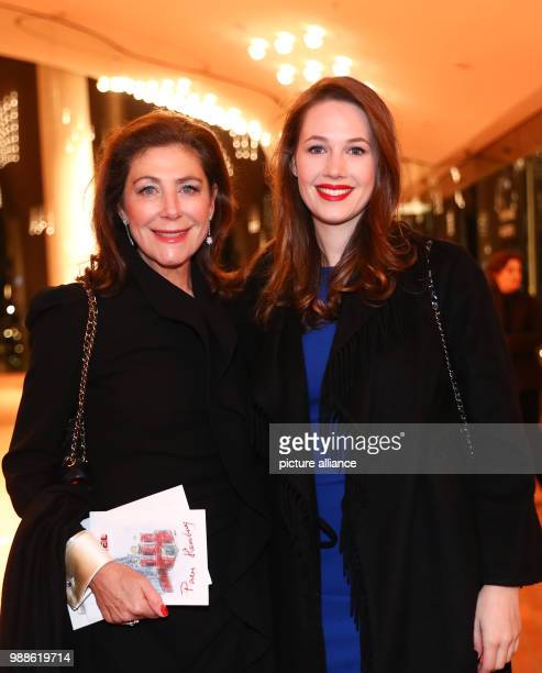 Alexandra von Rehlingen and daughter pose for the photocall at the Elbe Philarmonic Hall prior to Karl Lagerfeld's fashion show in Hamburg Germany 6...
